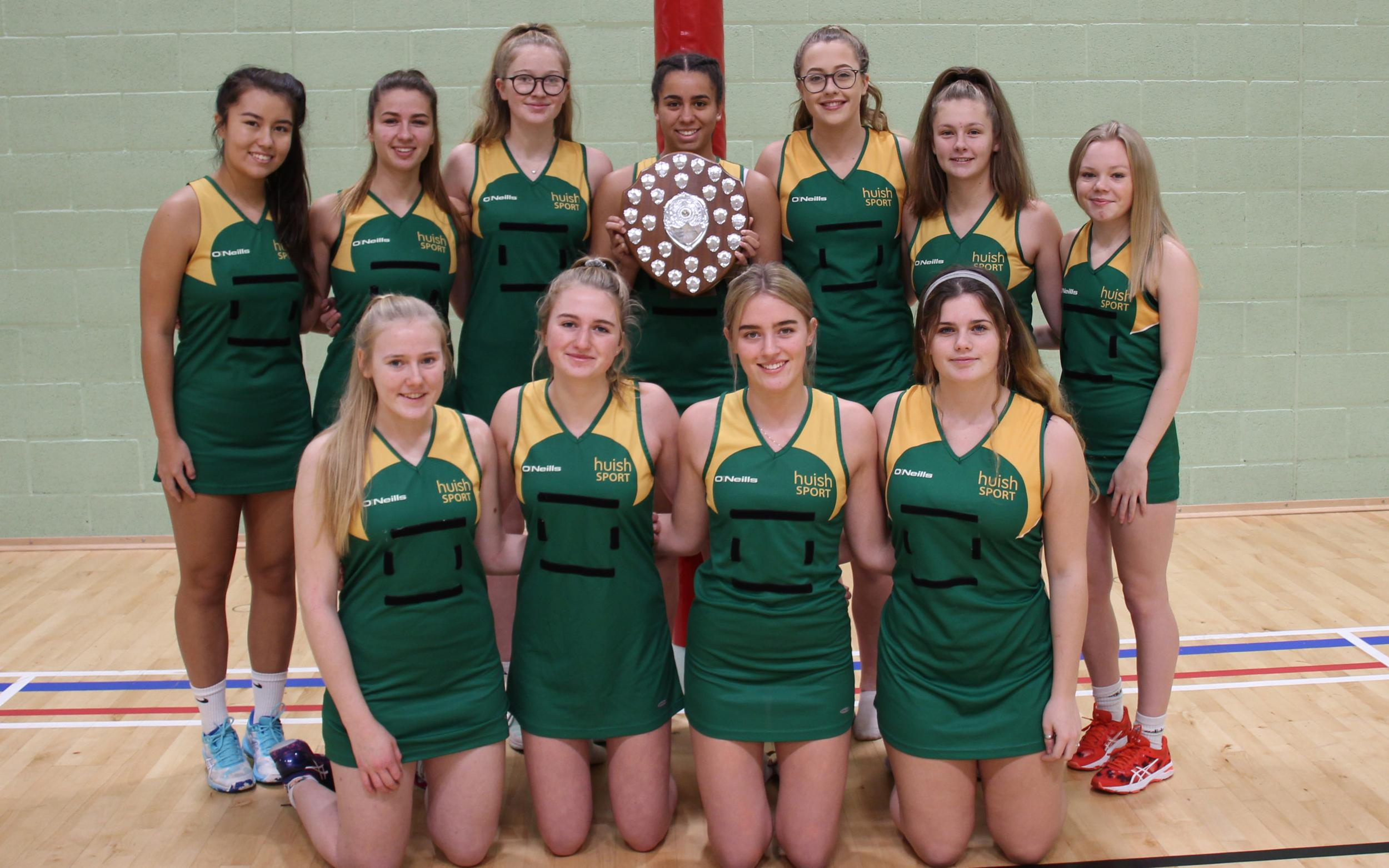Netball team with trophy