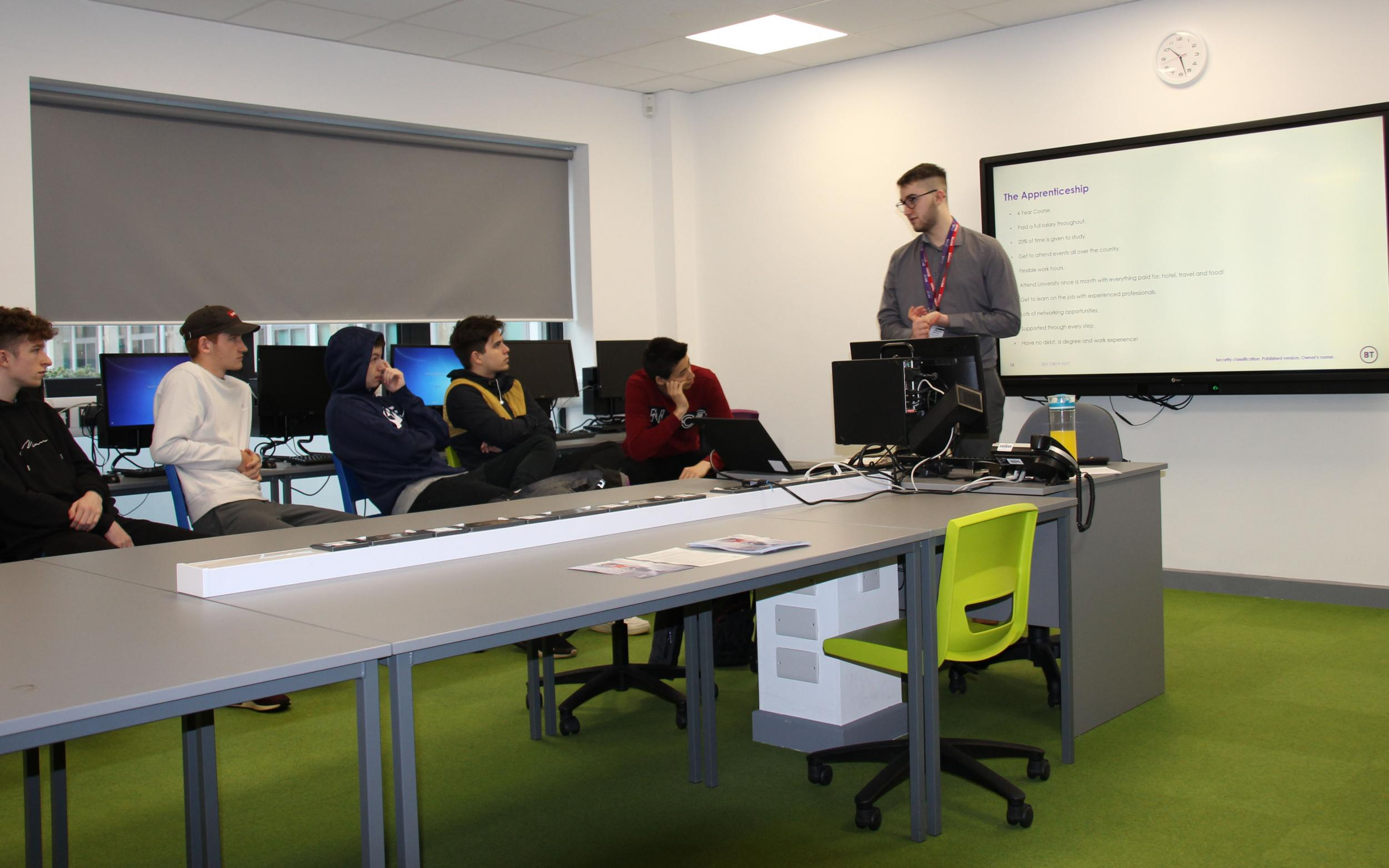 Will Manchip presenting to class of students in computing classroom