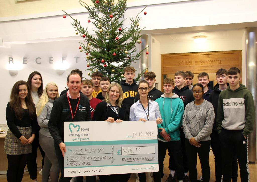 Students presenting cheque to Love Musgrove