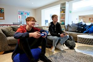 Two residents of Oak House playing video games