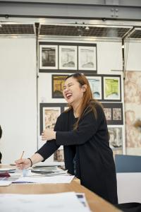 Student laughing in the art studio