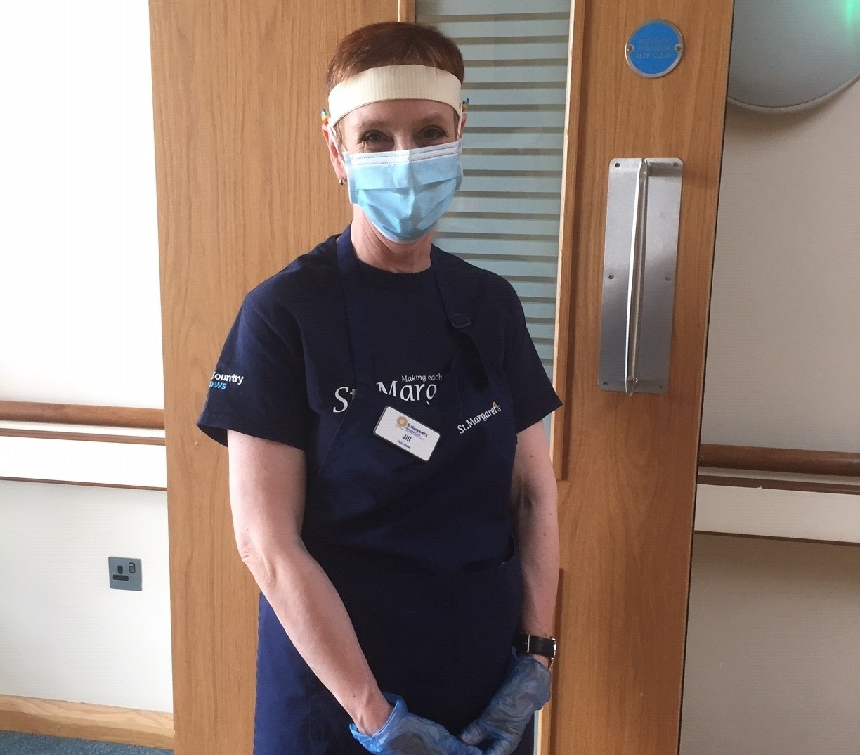 Jill Burton in St Margarets Hospice uniform and PPE
