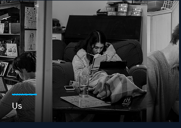 Photo entitled Us. A girl is in blanket writing on a notepad