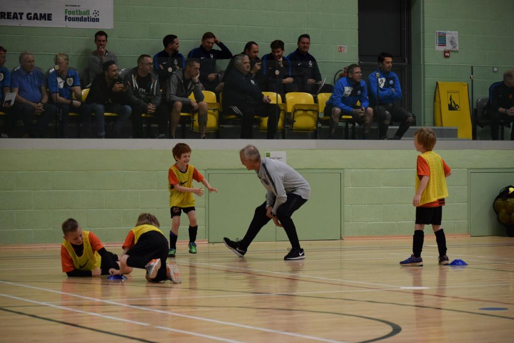 Pupils playing football in the Sportshall