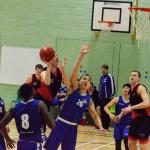 Huish Tiger boy jumping above opposition defender to shoot basketball