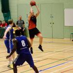 Huish Tiger player jumping with basketball mid game