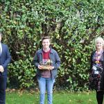 Joseph Bennett, James Morrelll and Helen Evans with trophy