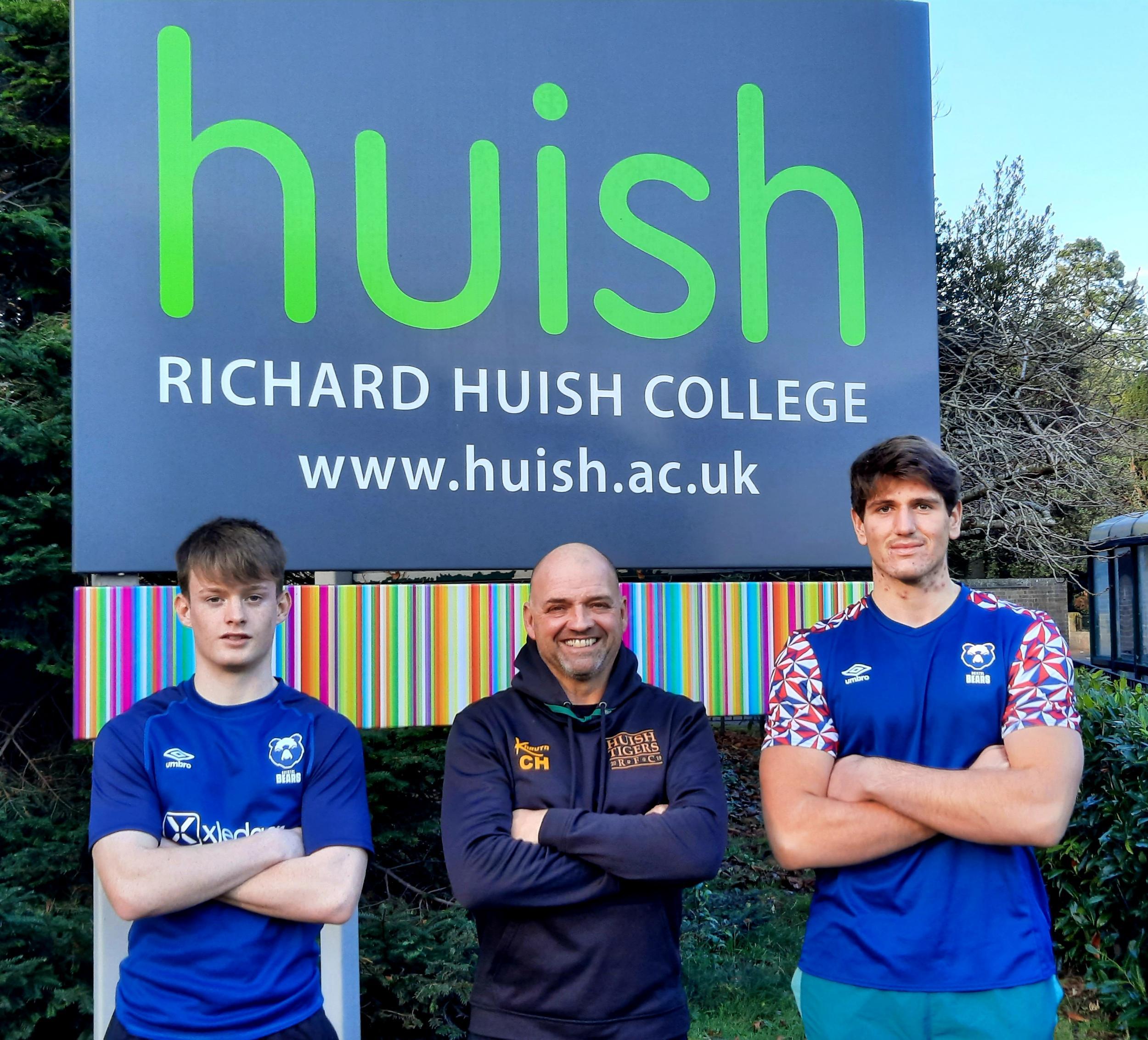 Joe Irons, Chris Heal, Costa Galatalis in front of Huish sign