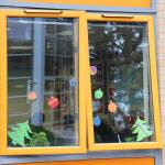 Paper baubles in window display