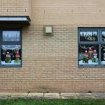 Photos of student support staff with santa hats in window display