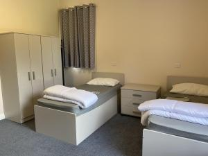 Two single beds and wardrobes