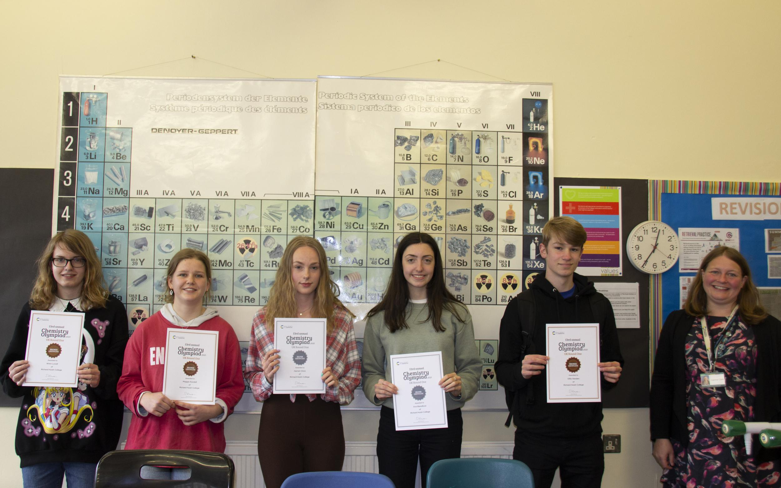 Chemistry students holding their certificates