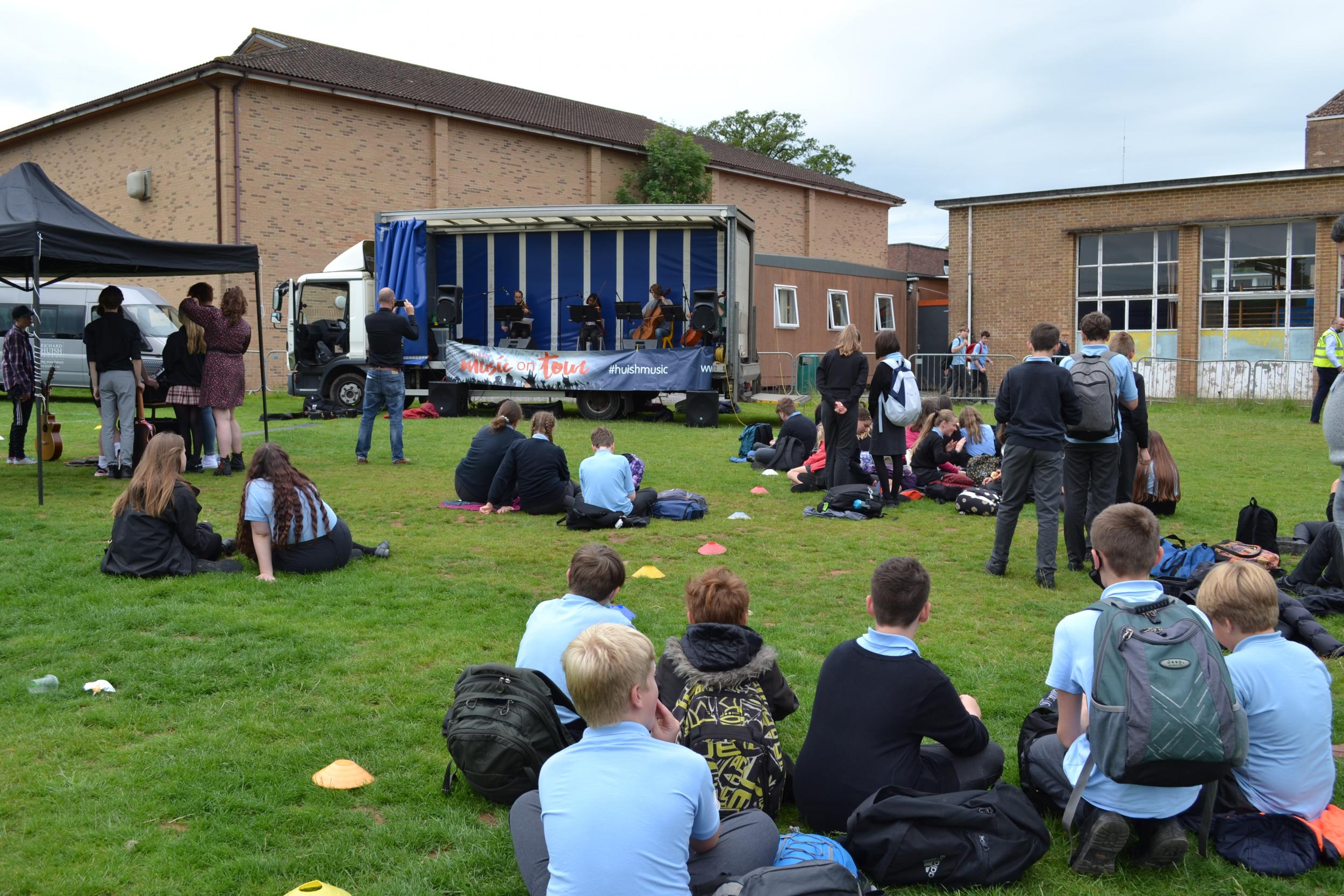 Huish students watching performers on lorry