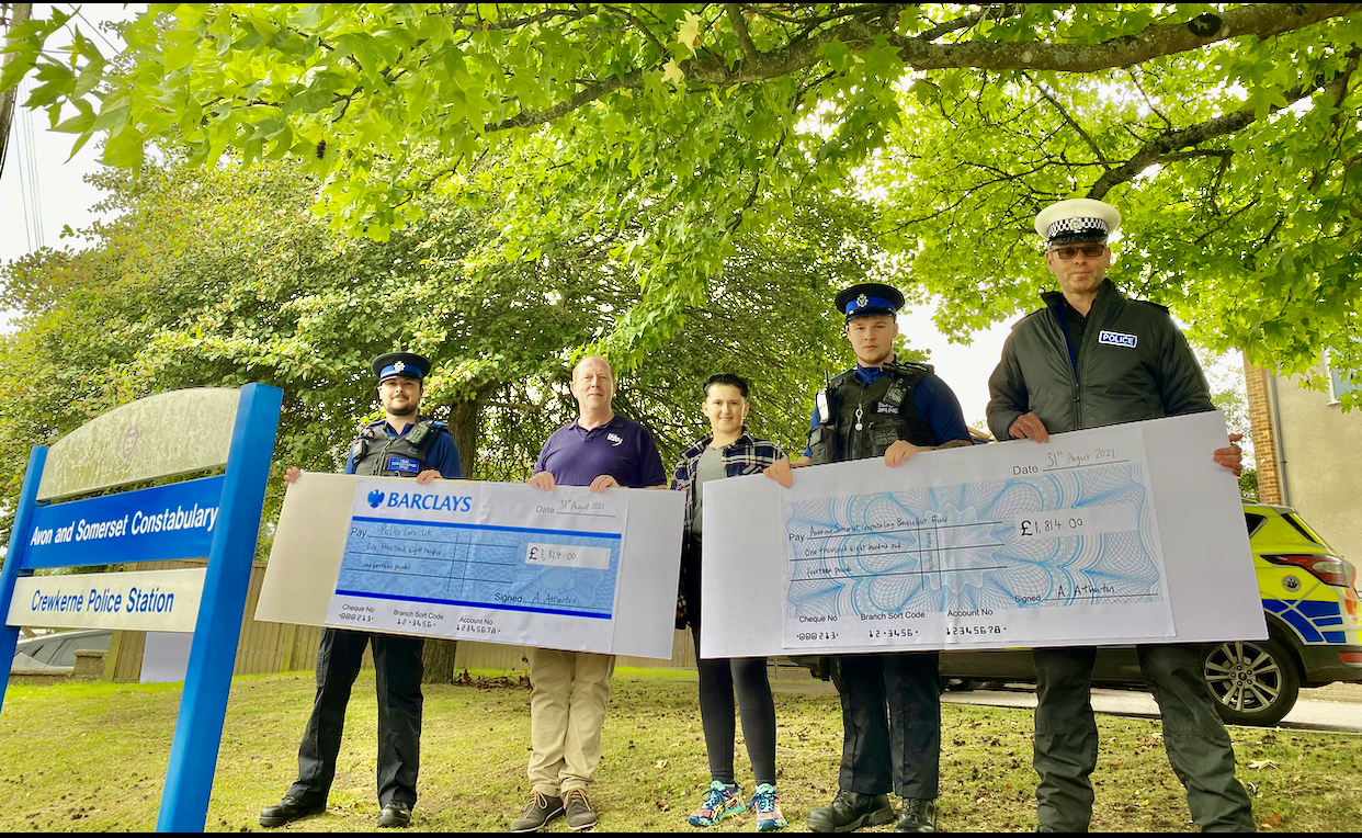 PCSO Wesley Ashbrook (Crewkerne Police), Brian Murphy (Police Care UK), Alex Atherton, PCSO Jack Beanland (Crewkerne Police), Sgt Andy Parsons (Avon & Somerset Benevolent Fund). holding giant cheques